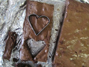 cutting out brownie hearts